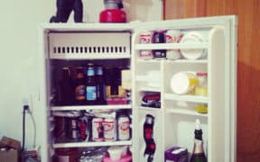 dorm fridge with drinks inside