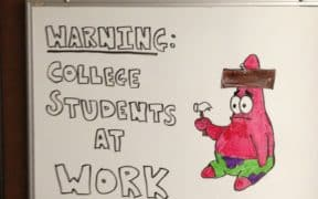whiteboard with text college students at work