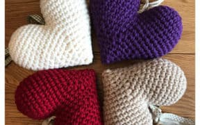 four knitted hearts