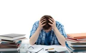 student holding head stressed