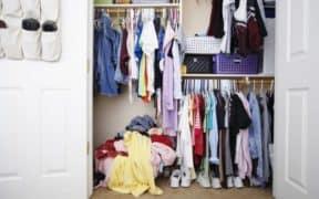 Dorm closet with clothes