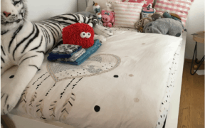 White Dorm Bed with Stuffed Animals